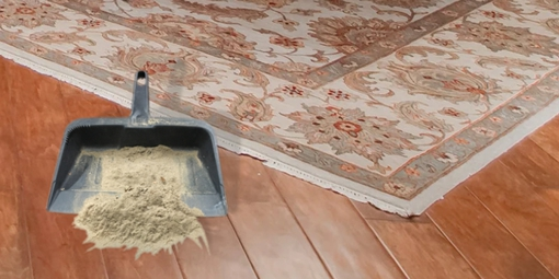 Dusting a rug for soil removal