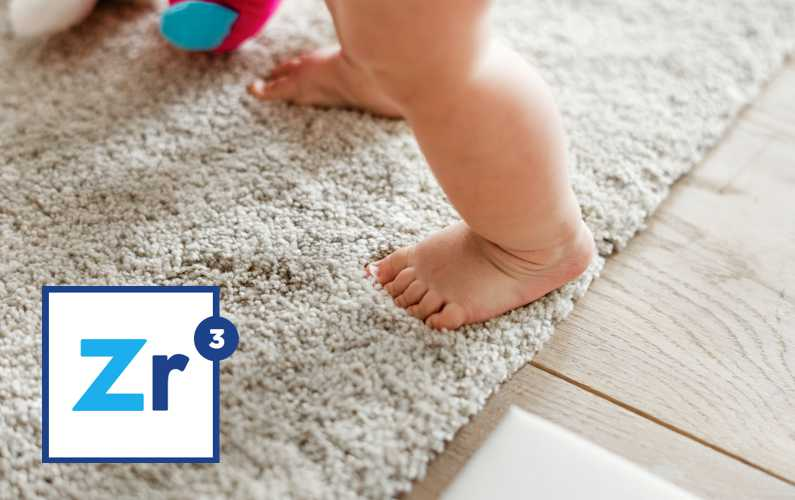 Baby standing on carpet