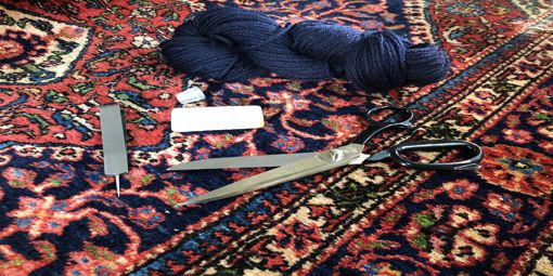 Rug repair tools on a rug